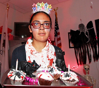 Candace H. Johnson-For Shaw Media Katie Ramirez, 16, of Round Lake shows off her scary cupcakes during the Haunted Trail at the Lindenhurst Park District's Community Center on Grass Lake Road.