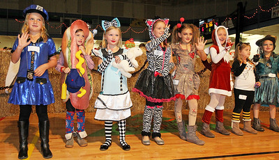 Candace H. Johnson-For Shaw Media Children ages 6-8 line up on the Cornstalk Stage for the Costume Contest and wave to their families during the Haunted Trail at the Lindenhurst Park District's Community Center on Grass Lake Road.