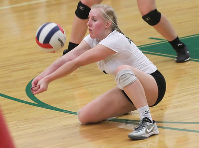 Candace H. Johnson-For Shaw Media Grayslake Central's Abby Marassa gets down low for the return against Grant in the third set at Grayslake Central High School. Grant won, (25-22, 26-28, 25-23)