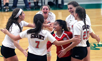 Candace H. Johnson-For Shaw Media Grant's Katy Fisherkeller (center) and her teammates celebrate a point against Grayslake Central in the third set at Grayslake Central High School. Grant won, (25-22, 26-28, 25-23)