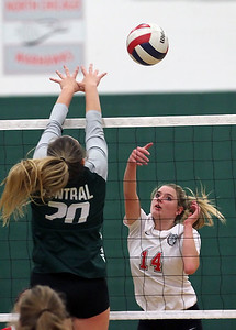 Candace H. Johnson-For Shaw Media Grayslake Central's Lauren LaBeck goes up for the block against Grant's Emily Bringer in the second set at Grayslake Central High School. Grant won, (25-22, 26-28, 25-23)