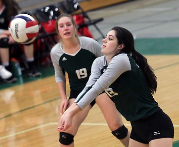 Candace H. Johnson-For Shaw Media Grayslake Central's Lizzie Twardock watches her teammate, Cassidy Beshel, bump the ball against Grant in the third set at Grayslake Central High School. Grant won, (25-22, 26-28, 25-23)