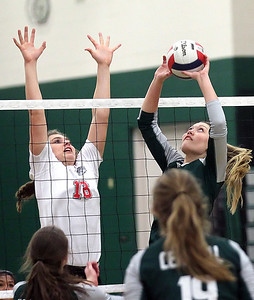 Candace H. Johnson-For Shaw Media Grant's Mallory Harrity goes up for a block against Grayslake Central's setter, Lauren LaBeck, in the second set at Grayslake Central High School. Grant won, (25-22, 26-28, 25-23)