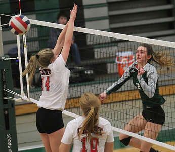 Candace H. Johnson-For Shaw Media Grant's Emily Bringer goes up for the block to stop an attack by Grayslake Central's Michelle Maraist in the third set at Grayslake Central High School. Grant won, (25-22, 26-28, 25-23)