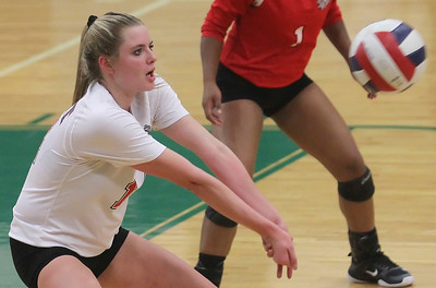 Candace H. Johnson-For Shaw Media Grant's Emily Bringer bumps the ball against Grayslake Central in the second set at Grayslake Central High School. Grant won, (25-22, 26-28, 25-23)