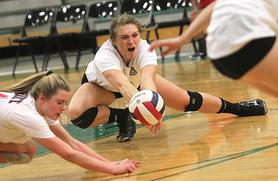 Candace H. Johnson-For Shaw Media Grant's Emily Bringer and Mallory Harrity get down low to save the ball against Grayslake Central in the second set at Grayslake Central High School. Grant won, (25-22, 26-28, 25-23)