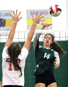 Candace H. Johnson-For Shaw Media Grant's Mallory Harrity goes up for a block against Grayslake Central's Kate Bullman in the first set at Grayslake Central High School. Grant won, (25-22, 26-28, 25-23)