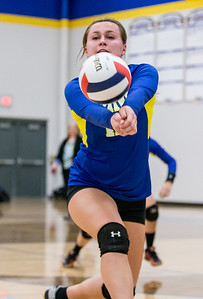 Ken Koontz - For Shaw Media Johnsburg High School's Megan Madsen makes a save Thursday, October 19, 2017 against Burlington Central in Johnsburg. Burlington Central went on to win in three sets and clinch the KRC Championship.
