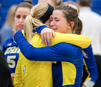 Ken Koontz - For Shaw Media Johnsburg High School volleyball players Kimmy Hammond (L) and Adisyn Illg console each other after Johnsburg falls to Burlington Central Thursday, October 19, 2017 in Johnsburg. With the win, Burlington Central clinches the KRC Championship.