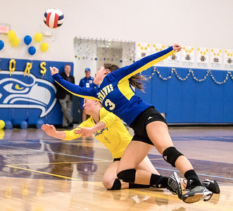 Ken Koontz - For Shaw Media Johnsburg High School volleyball players Adisyn Illg (R) and Kimmy Hammond collide while going for a save Thursday, October 19, 2017 against Burlington Central in Johnsburg. Burlington Central went on to win in three sets and clinch the KRC Championship.