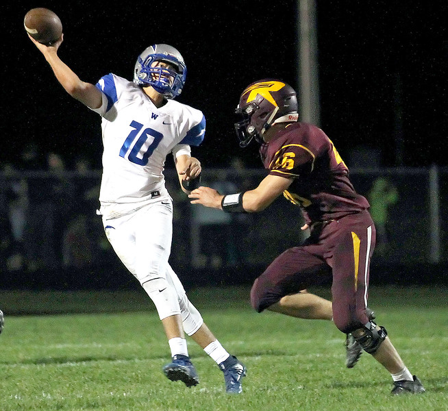 Candace H. Johnson-For Shaw Media Woodstock's quarterback Michael Purkey makes the pass against Richmond-Burton's Michael Kaufman in the second quarter at Richmond-Burton High School.