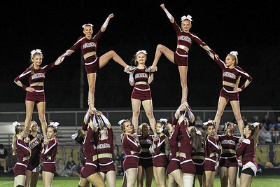 Candace H. Johnson-For Shaw Media Richmond-Burton's varsity cheer squad shows off their pyramid at half-time during the varsity football game against Woodstock at Richmond-Burton High School.