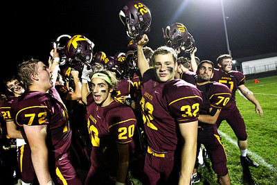 Candace H. Johnson-For Shaw Media Richmond-Burton's varsity football team celebrates clinching a playoff berth after having beaten Woodstock at Richmond-Burton High School.