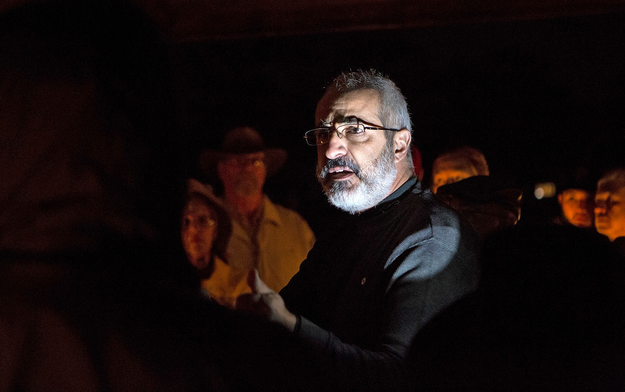 Mike Greene - For Shaw Media  George Kililis, of KRV Legal Inc., speaks to the crowd during a prayer vigil held in support of immigrants detained in the McHenry County Jail and threatened Dreamers Sunday, October 22, 2017 at Bates Park in Woodstock.