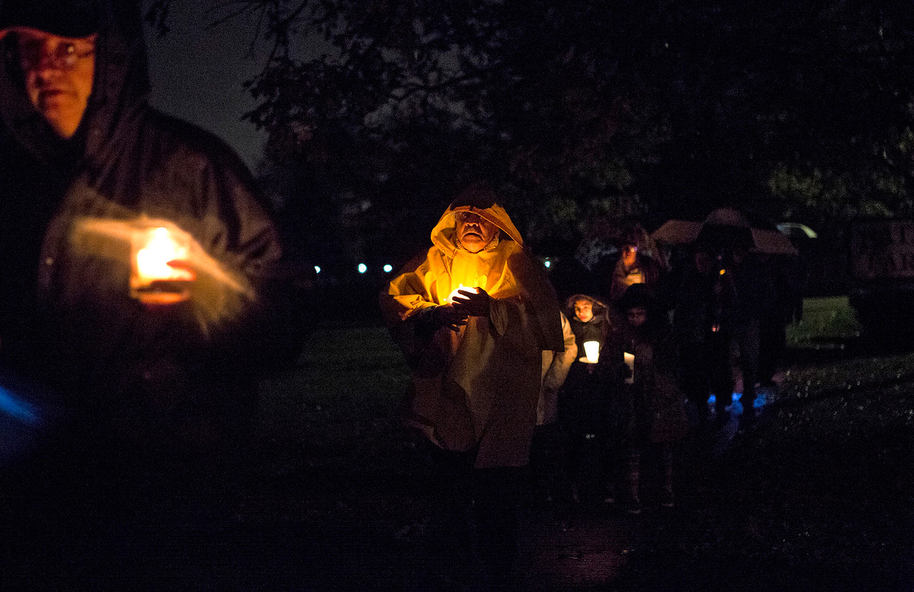 Mike Greene - For Shaw Media  Attendees of a prayer vigil held in support of immigrants detained in the McHenry County Jail and threatened Dreamers walk to the McHenry County Jail Sunday, October 22, 2017 in Woodstock.