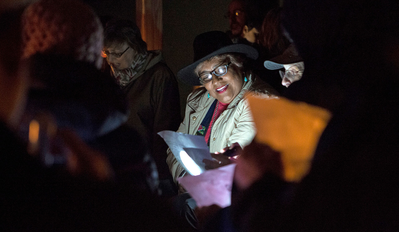 """Mike Greene - For Shaw Media  Guatemalan immigrant Luisa Lauf, of Woodstock, sings """"This Land is Your Land"""" during a prayer vigil held in support of immigrants detained in the McHenry County Jail and threatened Dreamers Sunday, October 22, 2017 at Bates Park in Woodstock. The event featured multiple speakers, prayers, and songs culminating in a candlelit walk to the McHenry County Jail."""