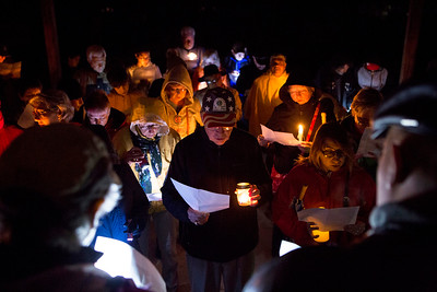 Mike Greene - For Shaw Media  Attendees recite verses during a prayer vigil held in support of immigrants detained in the McHenry County Jail and threatened Dreamers Sunday, October 22, 2017 at Bates Park in Woodstock. The event featured multiple speakers, prayers, and songs culminating in a candlelit walk to the McHenry County Jail.