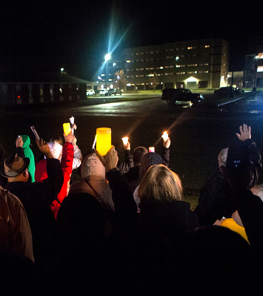 Mike Greene - For Shaw Media  Attendees of a prayer vigil held in support of immigrants detained in the McHenry County Jail hold candles to show their support Sunday, October 22, 2017 at the McHenry County Jail in Woodstock.