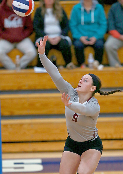 Joe Shuman - for Shaw Media Marengo's Emily Euker with the hit against Harvard defenders during the Class 3A Woodstock girls volleyball regional at Woodstock High School, Monday, Oct. 23, 2017. Marengo won, 2-0.