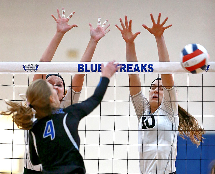 Joe Shuman - for Shaw Media Woodstock North's Grace Huelsman, (left) and Brooke Amann make a block against Woodstock defender Hanna Berry during the Class 3A Woodstock girls volleyball regional at Woodstock High School, Monday, Oct. 23, 2017. Woodstock North won, 2-0.