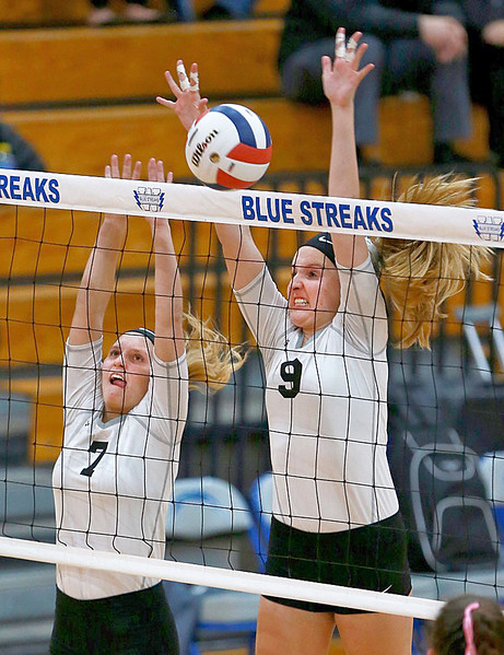 Joe Shuman - for Shaw Media Woodstock North's Emily Eder, (left) andGrace Huelsman against Woodstock defenders during the Class 3A Woodstock girls volleyball regional at Woodstock High School, Monday, Oct. 23, 2017. Woodstock North won, 2-0.