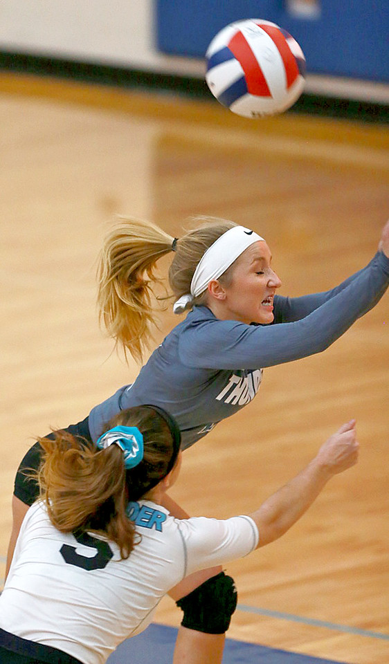 Joe Shuman - for Shaw Media Woodstock North's Lauren Kunke, (2) with the save against Woodstock during the Class 3A Woodstock girls volleyball regional at Woodstock High School, Monday, Oct. 23, 2017. Woodstock North won, 2-0.