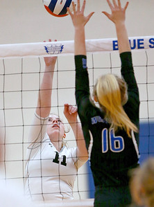 Joe Shuman - for Shaw Media Woodstock North's Ellen Kierna, (11) returns a volley against Woodstock defender Lauryn Hahn during the Class 3A Woodstock girls volleyball regional at Woodstock High School, Monday, Oct. 23, 2017. Woodstock North won, 2-0.
