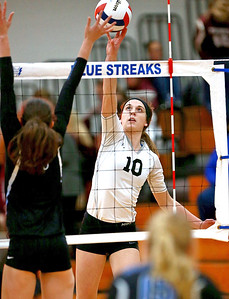 Joe Shuman - for Shaw Media Woodstock North's Brooke Amann against Woodstock North defender during the Class 3A Woodstock girls volleyball regional at Woodstock High School, Monday, Oct. 23, 2017. Woodstock North won, 2-0.