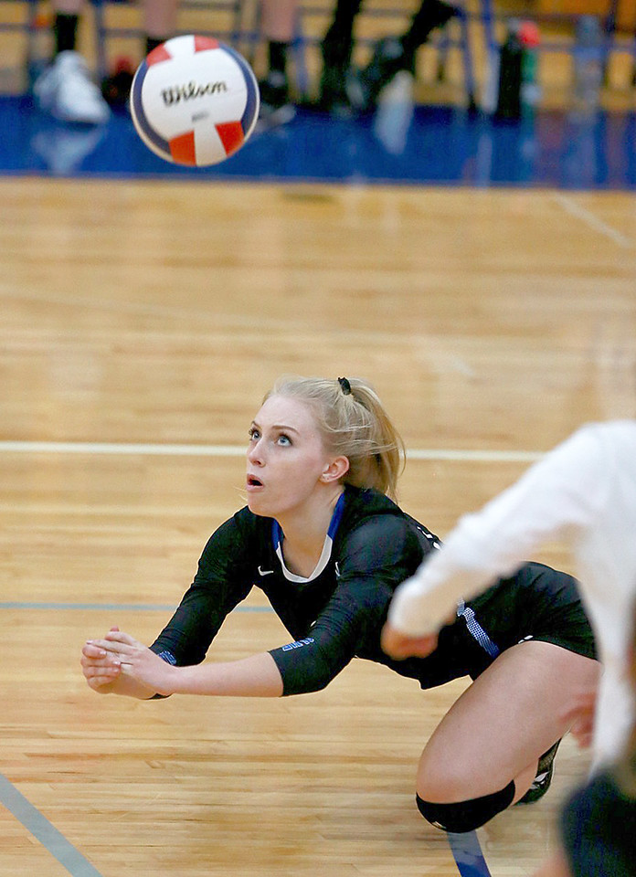 Joe Shuman - for Shaw Media Woodstock's Lauryn Hahn dives for the save against Woodstock North during the Class 3A Woodstock girls volleyball regional at Woodstock High School, Monday, Oct. 23, 2017. Woodstock North won, 2-0.