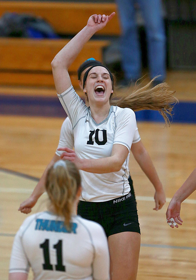 Joe Shuman - for Shaw Media Woodstock North's Brooke Amann celebrates the  2-0 win over Woodstock in the Class 3A Woodstock girls volleyball regional at Woodstock High School, Monday, Oct. 23, 2017.