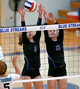 Joe Shuman - for Shaw Media Woodstock 's Julia Langton, (left) and Emma Branda against Woodstock North defenders during the Class 3A Woodstock girls volleyball regional at Woodstock High School, Monday, Oct. 23, 2017. Woodstock North won, 2-0.