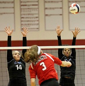 Candace H. Johnson-For Shaw Media Lakes Kelli Rettig and Paule Ceneac look to block a shot by Grant's Megan Mitchell in the first set during the Class 4A regional semifinal at Grant Community High School in Fox Lake. Lakes defeated Grant 25-11 in set 3 to advance to the championship match on Thursday at 6:00pm