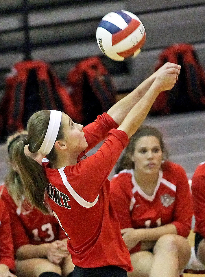 Candace H. Johnson-For Shaw Media Grant's Megan Mitchell bumps the ball for a return against Lakes in the first set during the Class 4A regional semifinal at Grant Community High School in Fox Lake. Lakes defeated Grant 25-11 in set 3 to advance to the championship match on Thursday at 6:00pm