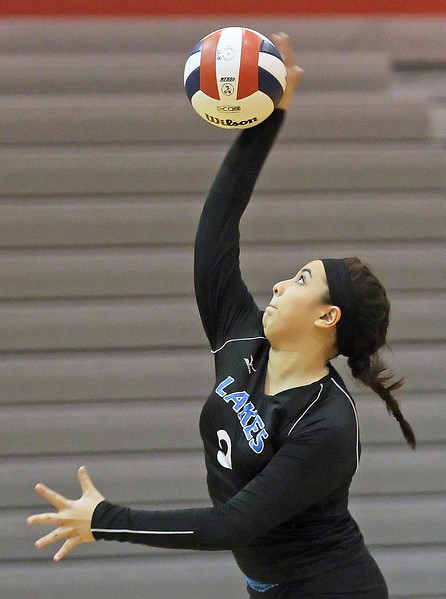 Candace H. Johnson-For Shaw Media Lakes Rachel Orpano serves against Grant in the second set during the Class 4A regional semifinal at Grant Community High School in Fox Lake. Lakes defeated Grant 25-11 in set 3 to advance to the championship match on Thursday at 6:00pm