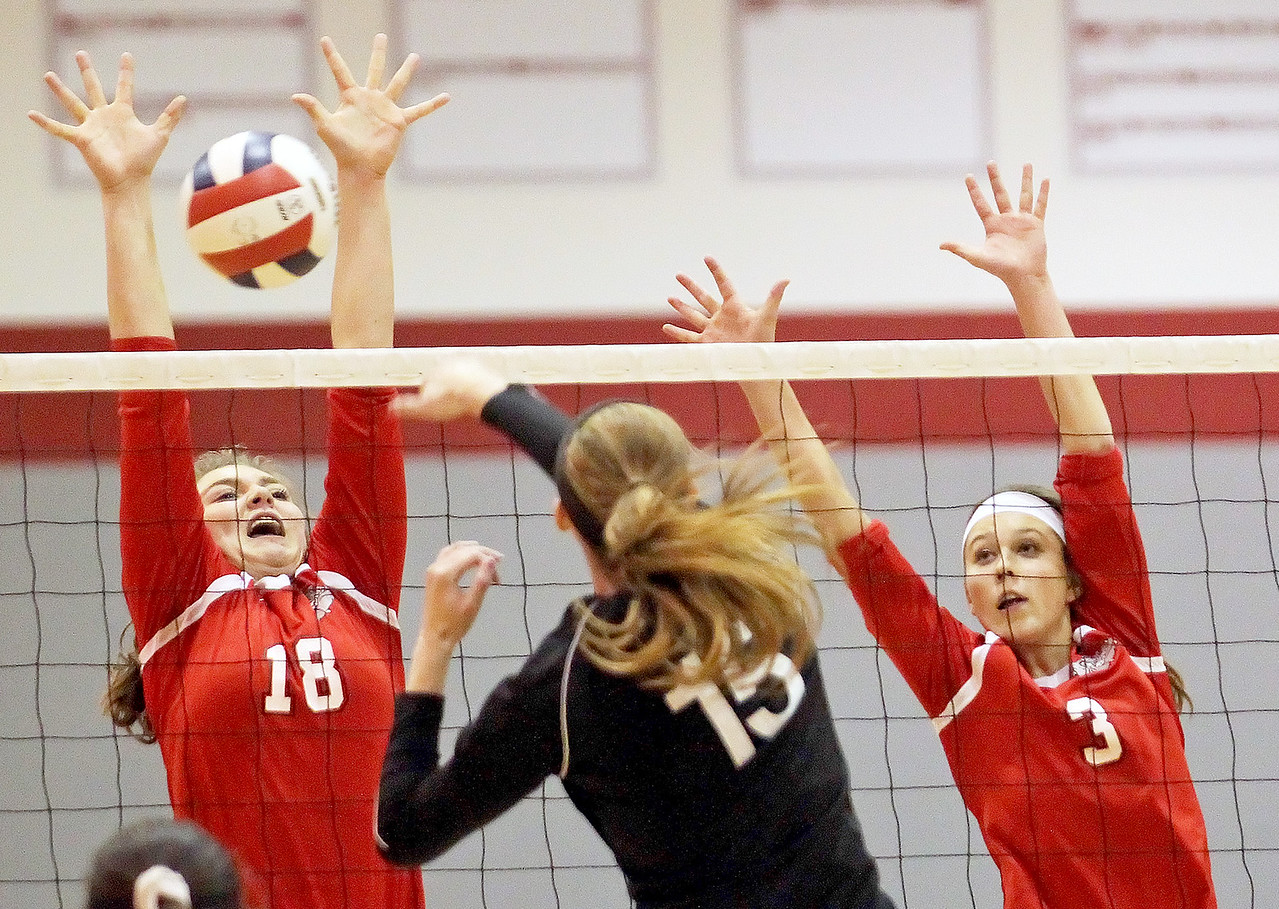 Candace H. Johnson-For Shaw Media Grant's Mallory Harrity and Megan Mitchell look to block a shot by Lakes Katherine Billetdeaux in the second set during the Class 4A regional semifinal at Grant Community High School in Fox Lake. Lakes defeated Grant 25-11 in set 3 to advance to the championship match on Thursday at 6:00pm
