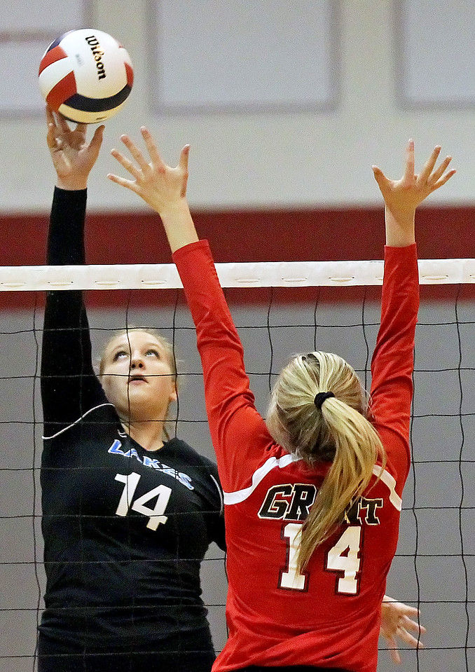 Candace H. Johnson-For Shaw Media Lakes Kelli Rettig tips the ball up high against Grant's Emily Bringer in the first set during the Class 4A regional semifinal at Grant Community High School in Fox Lake. Lakes defeated Grant 25-11 in set 3 to advance to the championship match on Thursday at 6:00pm