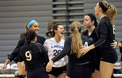 Candace H. Johnson-For Shaw Media The Lakes varsity volleyball team celebrates a point against Grant in the third set during the Class 4A regional semifinal at Grant Community High School in Fox Lake. Lakes defeated Grant 25-11 in set 3 to advance to the championship match on Thursday at 6:00pm