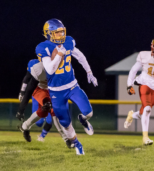 Johnsburg's Brody Frazier looks for running room after intercepting a pass Saturday, October 28, 2017 at Johnsburg High School. Johnsburg went on to beat Chicago Urban Prep / Englewood in the Class 4A playoff opener 47-0.  KKoontz – For Shaw Media