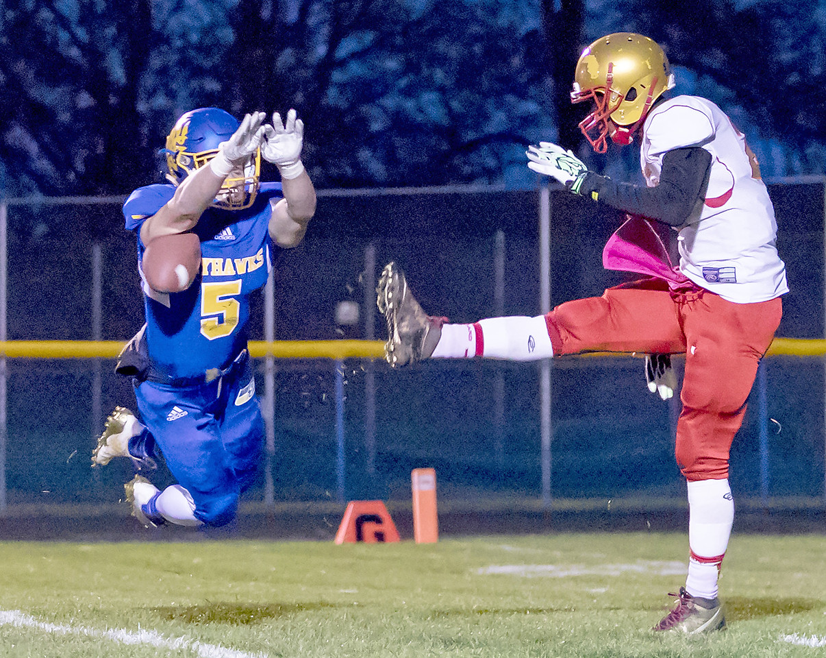 Johnsburg's Jack Kegel blocks a punt early in the first quarter of the Class 4A playoff game against Chicago Urban Prep / Englewood Saturday, October 28, 2017 in Johnsburg. Johnsburg wins big 47-0 and moves to 10-0 on the year. KKoontz – For Shaw Media