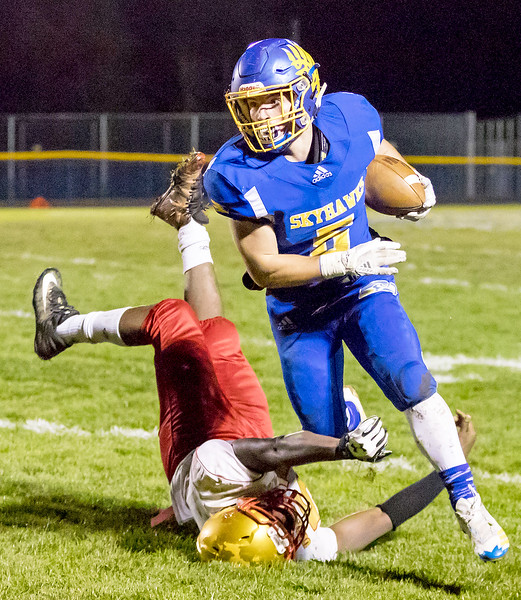 Johnsburg's Jack Kegel runs over a defender during the Class 4A playoff game against Chicago Urban Prep / Englewood Saturday, October 28, 2017 in Johnsburg. Johnsburg wins big 47-0 and moves to 10-0 on the year. KKoontz – For Shaw Media