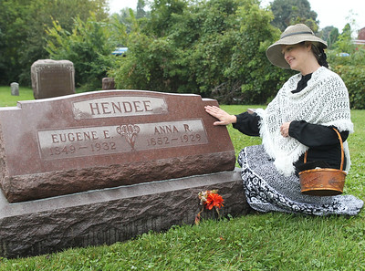 Virginia Fitzgerald, of Grayslake portrays Austrian immigrant Anna Ingrish Hendee (1852-1929) as she visits her grave before giving a talk about Hendee's life during the 21st Annual Living History Tour at the Grayslake Cemetery.Hendee escaped the Chicago Fire of 1871.  (9/30/18)