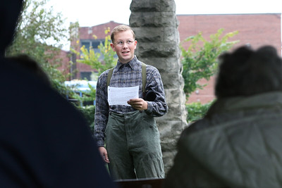 Max Gambony, 17, of Grayslake portrays William Hall (1875-1949) as he talks about being raised on a farm with his siblings and the Flood of 1881 which happened in his lifetime during the 21st Annual Living History Tour at the Grayslake Cemetery. The cemetery walk was hosted by the Grayslake Historical Society. (9/30/18)