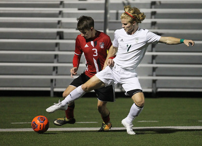 Candace H. Johnson-For Shaw Media Grant's Jacob Lotietko and Grayslake Central's Peder Harvey battle for control in the second half at Grant Community High School in Fox Lake. Grayslake Central won 3-1. (10/2/18)