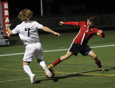 Candace H. Johnson-For Shaw Media Grayslake Central's Peder Harvey and Grant's Jacob Lotietko battle for control in the second half at Grant Community High School in Fox Lake. Grayslake Central won 3-1. (10/2/18)