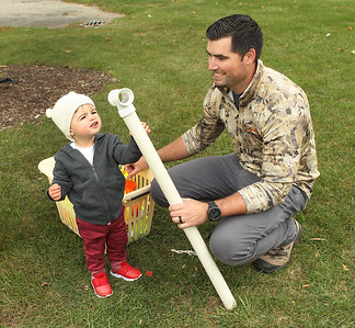 Candace H. Johnson-For Shaw Media Lorenzo Marturano, 2, of Spring Grove and his father, Vince, check out the PVC pipe in the Construct exhibit during the Busy Brains Children's Museum Fall Family Festival at Lehmann Park in Lake Villa. (9/29/18)