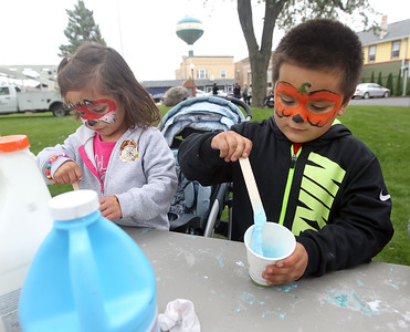 Candace H. Johnson-For Shaw Media Olivia Avila, 4, of Lake Villa and her brother, Anthony, 5, make slime using glue, water and liquid starch, during the Busy Brains Children's Museum Fall Family Festival at Lehmann Park in Lake Villa. (9/29/18)