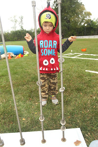 Candace H. Johnson-For Shaw Media Bennett Koch, 4, of Lake Villa learns how gravity works by playing with giant screws and washers during the Busy Brains Children's Museum Fall Family Festival at Lehmann Park in Lake Villa.Bennett was at the festival with his mother, Dana. (9/29/18)