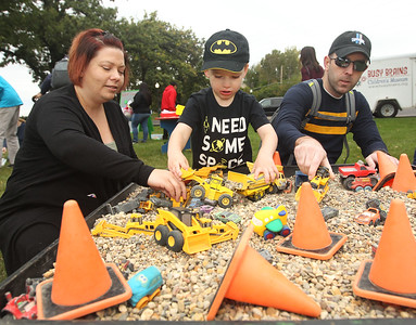 Candace H. Johnson-For Shaw Media Joyce and Mike Kendall, of Lake Villa and their son, Jack, 4, have fun playing with toy trucks at the rock table during the Busy Brains Children's Museum Fall Family Festival at Lehmann Park in Lake Villa. (9/29/18)