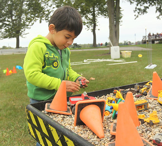 Candace H. Johnson-For Shaw Media Rafael White, 3, of Gurnee plays with toy trucks at the rock table during the Busy Brains Children's Museum Fall Family Festival at Lehmann Park in Lake Villa. (9/29/18)