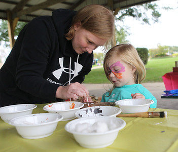 Candace H. Johnson-For Shaw Media Samantha Kurtz, of Salem, Wis., and her daughter, Payton, 4, paint a dalmation dog on reclaimed wood during the Busy Brains Children's Museum Fall Family Festival at Lehmann Park in Lake Villa. (9/29/18)